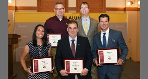 James Murphy with Dean Kyle Squires of the Ira A. Fulton School of Engineering to his left, and additional alum recipients of the Sun Devil 100 award.